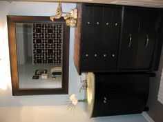 Our new main bath we just remodeled!  The dresser we found on the side of the road and refinished it to match our vanity.  We thought putting them together was way more fun than getting a traditional counter top vanity!  Total cost was around $450!