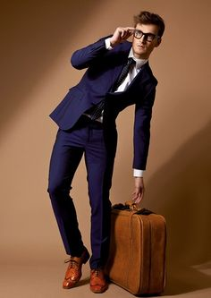 Daper menswear fashion editorial - navy blue tailored suit - http://pinterest.com/arenaint