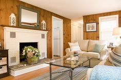 An updated room with knotty pine paneling with white trim....still too formal for 1715EGBD.  Needs brighter colors & white