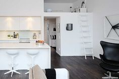 All my favorite colors here: dark floors, lots of white, a few drops of color here and there