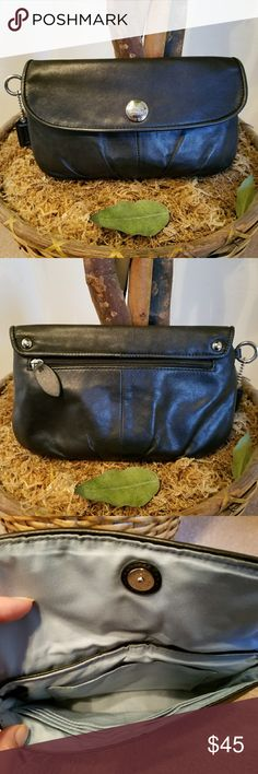 """Large Coach Wristlet Clutch Brand: Coach  Color: Black exterior/ blue interior  Leather  100% Authentic  Magnetic closure in the front, zipper in the back.   Large Wristlet  Approximately 9"""" × 5  1/2""""  The strap is missing but the bag is otherwise in excellent condition. Zoom in to see how good it looks. You can buy a leather strap to attach it if needed to be used as a wristlet or without the strap as is, to be used as a clutch. Leather straps are sold for less than $10.    Tags: PURSE…"""