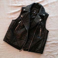 moto vest Worn only twice. Great Condition. Size S, TTS. Faux leather. Lined. Measurements will be added soon. Not Modeling. No Hold. No Trades. Price is Firm. American Eagle Outfitters Jackets & Coats Vests