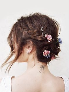 Lucy Hale's flower-topped braided updo hairstyle - click through for the how-to! (PS: How gorgeous would this be for a wedding?)