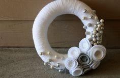 yarn and felt wreath with a few beads