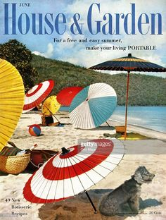 House & Garden logo in blue superimposed over photo of beach with colorful Japanese umbrellas.