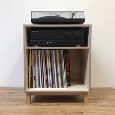 Our new turntable console houses your turntable, amplifier and 100 records in style. Made from sustainable birch plywood with an intense black finish on the top and sides and sits on solid oak legs. Dimensions: h630 x w 510 x d400mm Made to order please allow up to 4 weeks for