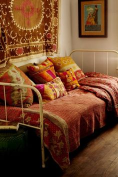 day bed with indian textiles embroidered pillows and suzanni wall tapestry