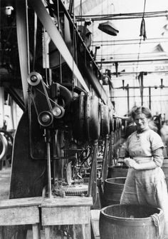 INDUSTRY DURING FIRST WORLD WAR BIRMINGHAM (Q 54340)   A female worker manufacturing .303-inch ammunition cartridges at Kynoch's factory in Birmingham during the First World War.