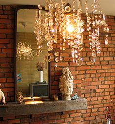 I love crystal and brick.  And this is a fake chandelier! (the crystals are strung on fishing line and hang individually from the ceiling around a clear bulb)