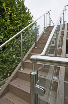 Tigerwood decking that doesn't warp or splinter A closer look at that gorgeous glass balustrade. These steps were also created using our EasyClean Legacy Tigerwood decking. Wood Railings For Stairs, Outdoor Handrail, Staircase Railing Design, Balcony Railing Design, Home Stairs Design, Deck Design, Balcony Glass Design, Glass Balcony, Glass Stair Balustrade
