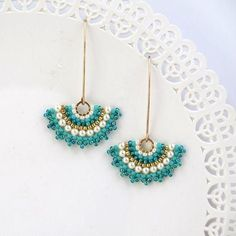 I created this turquoise dangle earrings by hand, using Swarovski pearls 3mm , Miyuki round seed beads, Miyuki Delica beads and 14k goldfilled Ear-wire * Measurements: Earring length: 1.96 (5cm) Fan element diameter: 1.18 (3cm) * The earrings will come beautifully packaged for gift.