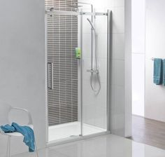 Compact shower space with a polished chrome frame and clear glass shower door