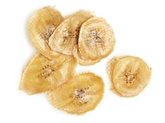 Banana Chips : Slice a banana into 1/8-inch-thick rounds and lay on a greased baking sheet. Bake at 200 degrees F until golden, 2 to 3 hours. Let harden at room temperature.