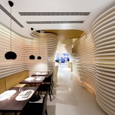 Love the sculpted walls: Sushi Café Avenida in Lisbon, Portugal. Designed by Saraiva + Associados