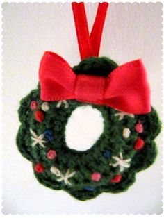 crochet christmas ornament wreath. My grandmother made tons of these when I was a kid. I'm blessed to still have a few to put on our tree!!!