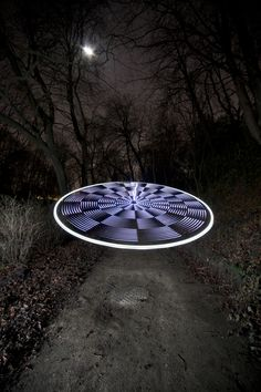 """This image is titled """"UFO by moonlight"""". 