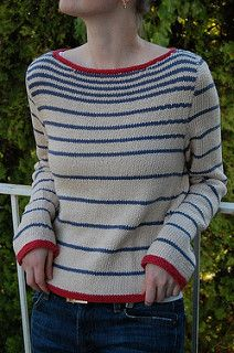 Blue-and-white is always a fresh color combination, but this jaunty nautical-style sweater also has a bright red edging for extra zing.