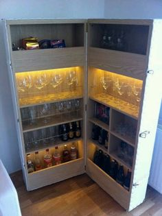 Bar Trunk - just ordinary shelves hinged and covered to look like a trunk. I would use this as a clever organization solution for a child's room:)