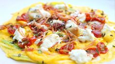 Egg fritata/open faced omelette  with roasted cherry tomatoes, garlic confit, bacon, scallions and goat cheese.