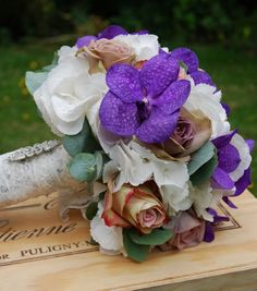 Glamorous vintage pink #bridalbouquet of Amnesia and Upper Secret roses with purple vanda orchids. Love the vintage lace! Design by Lily and May