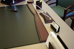 A leather desk blotter on an office desk makes a huge difference.
