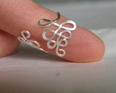 Anillo del dedo del pie y el oído del pun o Swirls por junesky