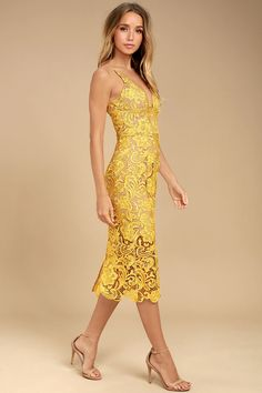 Sexy, stunning, and chic, the Dress the Population Marie Yellow Lace Midi Dress really is the perfect dress! Nude lining and yellow crochet lace form a plunging V-neck, and a darted, sleeveless bodice supported by skinny straps. Sheath midi skirt ends with a sheer panel of scalloped lace. Kick pleat at back. Hidden back zipper.