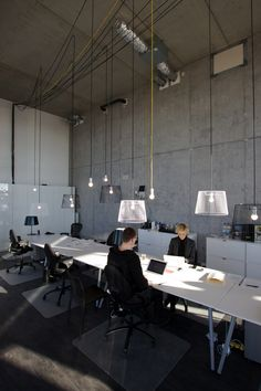 Shared work benches can work but it has to have atmosphere,  human detail like the lamps . The office :: Amsterdam IJburg #workplace