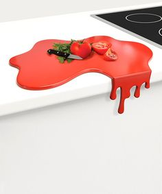 Crafted to look like an unintended splash, this chopping board features a clever design that keeps it in place against the edge of the counter. Slice and dice away on this stable piece, then remove the vertical piece and use it as a flat surface.14.45'' W x 4.25'' H x 11.06'' DNylonDishwasher-safeImported