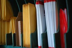 Slat filers or magazine filers to store shipping envelopes