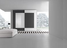 Wardrobe with panels in gloss bianco candido lacquered glass and matt grigio antracite lacquered glass.__ Armadio con pannelli in vetro colorato lucido bianco candido e vetro colorato opaco grigio antracite.