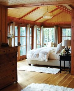 Summer Home Decorating Ideas Inspired by Rustic Simplicity of Canadian Cottages Enclosed Cottage Porch (© Janet Kimber). This has lots of elements I'd love- french doors, wood beams Cabin Homes, Log Homes, Porche Chalet, Block House, Lodge Bedroom, Cozy Bedroom, Bedroom Windows, Bedroom Rustic, Bedroom Ceiling