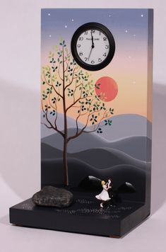 Pinkish Glow Waltz by Pascale Judet. This clock is hand painted with acrylic on MDF, a wood product. The figures are HO scale figures made by Preiser. The clock is signed by the artist on the back. Battery operated.