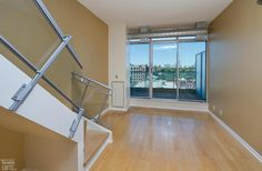 District Lofts-388 Richmond St W #717  | 800+/- sf Demand 2 level, 2 bedroom thru-suite with dual North & South exposures & private balcony! Features floor to ceiling windows, upgraded wood floors on both levels + stairs, granite counters with breakfast bar and custom built-in master bedroom closet! Also includes 1 owned pkg. | More info here: torontolofts.ca/district-lofts-lofts-for-rent/388-richmond-st-w-717-1 2 Bedroom For Rent, Toronto Lofts, Lofts For Rent, Master Bedroom Closet, Floor To Ceiling Windows, Granite Counters, Home Buying, The Unit, North South