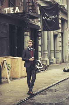 Dark red undercoat always matches a dark suit.