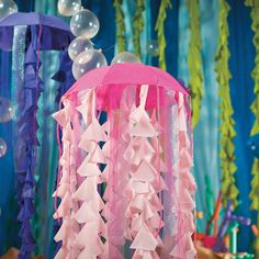 Your Under the Sea VBS will need some sea life, and this DIY jelly fish is a natural choice! Follow our simple instructions to make your own jelly fish VBS decoration.