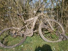 abandoned bicycle covered in dust or dried mud