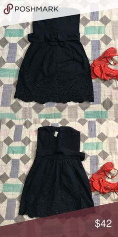 0a64e42fc24 Hollister Strapless Eyelet Dress Tube top dress with embroidery across the  bottom of the dress. Removable belt and a elastic scrunch back. New with  tags.
