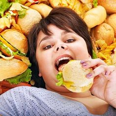 Picture of Overweight woman holding hamburger. stock photo, images and stock photography. Hamburger, Diet Tracker, Learning To Say No, Prevent Diabetes, Herzog, Calorie Intake, Why People, Genetics, Hot Dog Buns