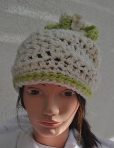Winter white and soft lime green with flowers and leaves on top.  Super soft.