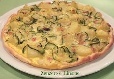 TORTA SALATA con ZUCCHINE, PATATE e MOZZARELLA   INGREDIENTI 1 rotolo di pasta brisée 2 mozzarelle 1 zucchina 2/3 patate 1 uovo 1 spicchio di aglio 1 rametto di rosmarino un po' di latte pane grattugiato parmigiano o grana grattugiato olio extra vergine d'oliva sale Best Dinner Recipes, Vegetarian Recipes Dinner, Veggie Recipes, Healthy Recipes, I Love Food, Good Food, Yummy Food, Kitchen Recipes, Cooking Recipes