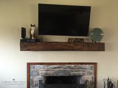 Fireplace mantel custom made from antique reclaimed barn wood. Simplicity in the arrangement of the fireplace, mantel, and decorations creates a cozy, easy-going environment in the home. Add character to the home with historical custom-made barn wood furniture. E. Braun Farm Tables and Furniture - showroom located in the heart of Amish country, Lancaster County, PA. www.braunfarmtables.com