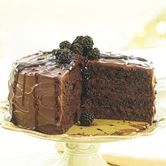 Chocolate and spices mingle with sweet blackberries under a robe of chocolate fudge icing drizzled with blackberry sauce. Even grandmothers would be pleased with this updated classic.