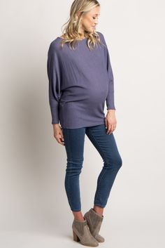 50a60ee275a8a4 A solid cold shoulder maternity top. Rounded neckline. Long sleeves ...