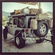 Jeep JK getting ready for the trails .I love the keg on top lol. Jeep Jk, Auto Jeep, Jeep Truck, Ford Trucks, Jeep Camping, Jeep Wrangler Camping, Bug Out Vehicle, Rangement Caravaning, Jeep Carros