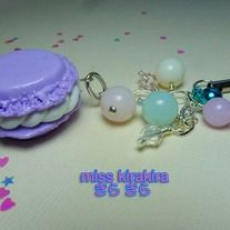 This macaroon was made with polymer clay and glazed with triple thick glaze.    There are plastic pastel beads on this keychain that is attached to a silver plated chain. A bell is attached to this keychain.