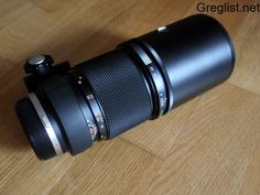 Objectif Olympus 300 mm Lausanne - Greglist