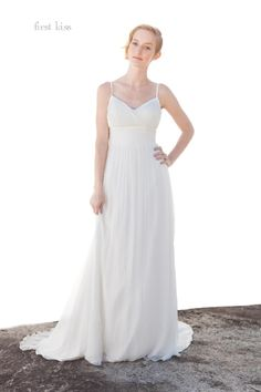 Love this wedding gown?  You can love it beyond your wedding day because it was designed to be dyed another color!  I can see this gown flowing in the breeze at a beach ceremony, then burning up the dance floor as a deep pink party dress years later!