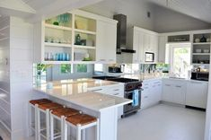 Lynn Morgan Design: Fresh modern kitchen design with gray walls paint color, white cabinets, quartz counter ...