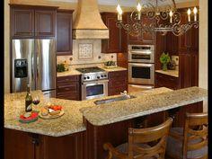 Elegant tuscan kitchen cabinet design with chandeliers